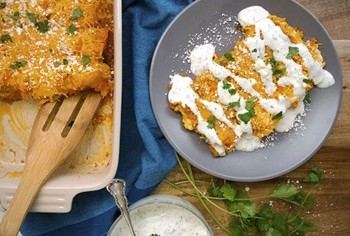 Buffalo Chicken Enchiladas with Cilantro Sour Cream Sauce