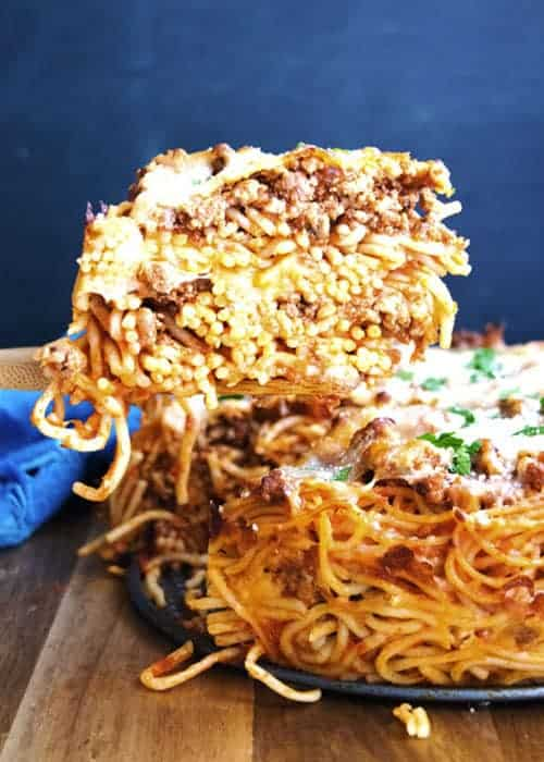 Spaghetti Pie is a whimsical take on the classic spaghetti and meat sauce we all grew up with. It's similar to a baked ziti, but uses spaghetti noodles instead. I love this cheesy comfort food dinner recipe.