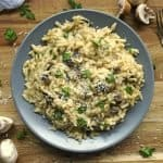 30 Minute Mushroom Orzo Risotto is a creamy dinner recipe or side dish recipe. The meaty mushroom are a perfect compliment to this velvety pasta. I am in love with this quick and easy risotto. This dish makes a great dinner, or a quick side dish.