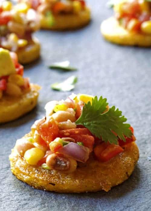 Black Eyed Pea Salsa with Crispy Polenta is a great vegan appetizer for any special occasion. I love it for New Year's Eve appetizer since black eyed peas are good luck. The crispy polenta adds some elegance to this salsa.
