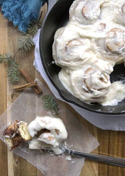 Freezer Friendly Cinnamon Rolls are a classic holiday recipe. This recipe came from Paula Deen, but I use cream cheese icing instead of glaze. These decadent rolls make Christmas brunch extra special. They are a tradition at our house. Serve them as a Christmas breakfast recipe, or for a dessert recipe.