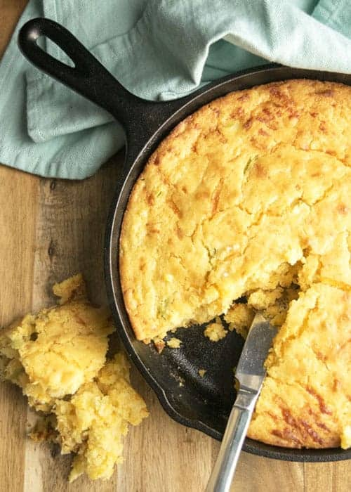 Cheesy Jalapeño Cornbread is a great side dish. It pairs well with beans and rice or chili. This cornbread is sweet, cheesy, savory and spicy! I love it