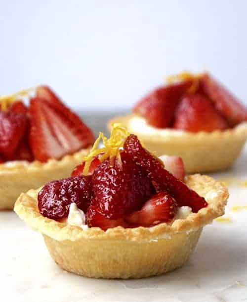 Impress your sweetheart or guests with these Cream Cheese Tarts with Sweet Berries. This beautiful dessert looks complicated, but it's easy to whip together. I love this for a Valentine's Day dessert!