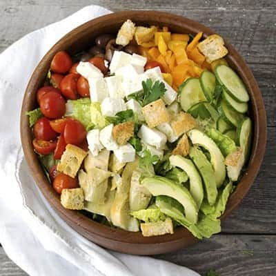 This Big Greek Salad is a go to when I crave something healthy and delicious. Load it up with some chicken or shrimp for a hearty dinner salad. My homemade dressing is easy to whip up and so much better than those bottled dressings. | The Hungry Waitress