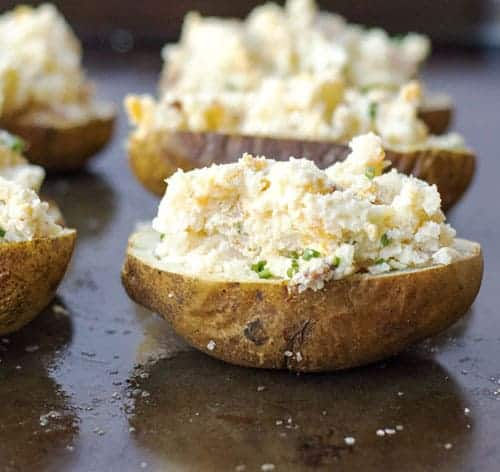 Classic Twice Baked Potatoes are a staple side dish recipe everyone should have in their recipe collection. This simple version will make any dinner feel special.