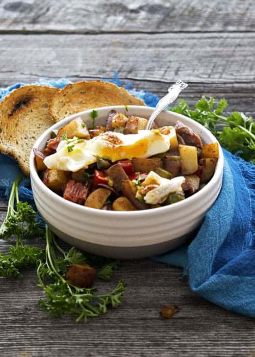 Corned Beef Hash is a perfect recipe to use up all of that leftover corn beef! It makes a quick dinner recipe, breakfast recipe, and brunch! A poached egg on top is a must!