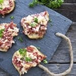 Open-Faced Reubens are a lazy way to eat a reuben. These could make a great appetizer for St. Patrick's or a simple weeknight dinner. Most importantly they are a super fast recipe!