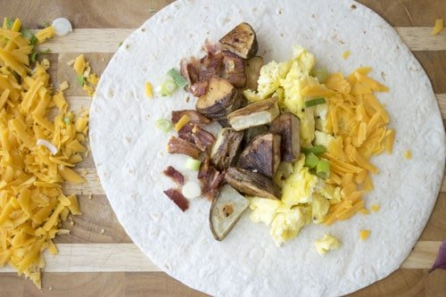 Breakfast Burritos are a great way to use up breakfast or brunch leftovers. They are freezer friendly too!