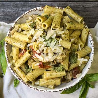 Easy Chicken Pesto is a great weeknight dinner. This pesto pasta is a 30 minute dinner, and it's a crowd pleaser!