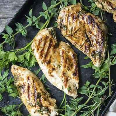 This Easy Greek Chicken recipe is packed with flavor, but only takes 30 minutes to make. It is perfect for a fast quick weekday dinner.
