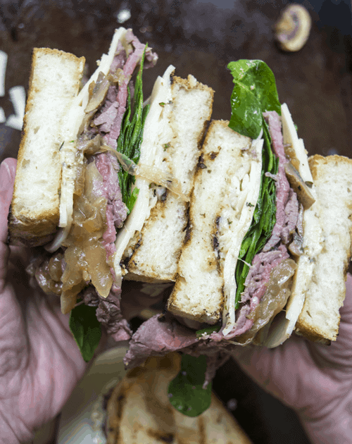 Use up your steak leftovers with these Steak Sandwiches with Pesto Mayonnaise! These sandwiches contain sauted mushrooms and onions, spinach, thinly sliced sirloin, and pesto mayonnaise!