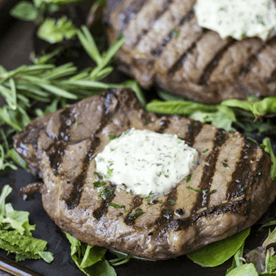 This Easy Grilled Sirloin recipe is perfect for any summer cook out! This easy grilling recipe starts the night before with a dry brine, and finished with an herb butter!