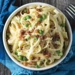 Yum! Fettuccine Alfredo with Pancetta and Peas is a perfect easy dinner recipes for special occasions. This creamy pasta recipe is a crowd pleaser!