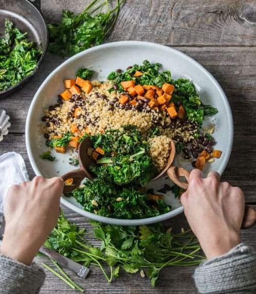 Stirring up this Vegan Sweet Potato and Black Bean Bowl is an easy meal prep recipe. This vegan recipe is great for lunch or dinner!