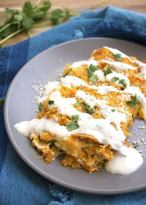 Buffalo Chicken Enchiladas with Cilantro Sour Cream Sauce