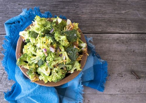Broccoli Salad is the best for a picnic side, barbeque side, or grill out side dish. The simple salad is basically a cole slaw with bacon, cheese, and yummy pecans. This recipe is husband/boyfriend approved.