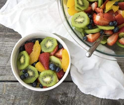 Easy Fruit Salad is a refreshing salad recipe perfect for summer. Take any fruit and mix it with this simple dressing, and you have a fancy fruit salad recipe in seconds!