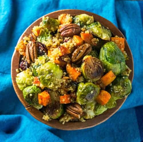 This Easy Fall Quinoa Bowl recipe is packed with roasted brussel sprout, sweet potatoes, quinoa, pecans, and topped with an apple cider vinaigrette. It's an easy dinner recipe, and perfect for meal prepping, and as a side dish!
