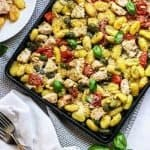 Sheet pan full of chicken, gnocchi, and vegetables
