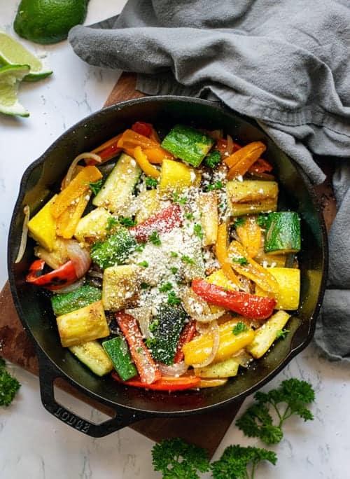 skillet full of summer vegetables