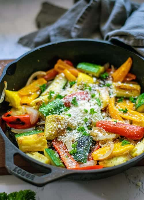 cast iron skillet with zucchini and bell peppers