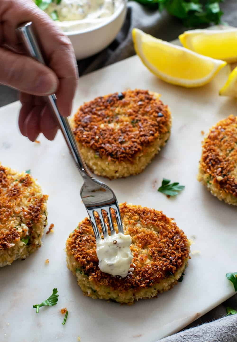 bite of easy homemade tartar sauce on a crispy crab cake