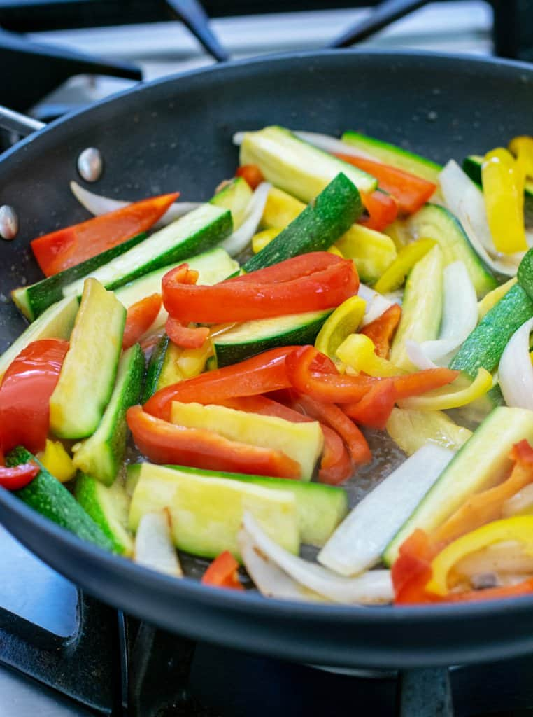 pan of sizzling peppers and onions