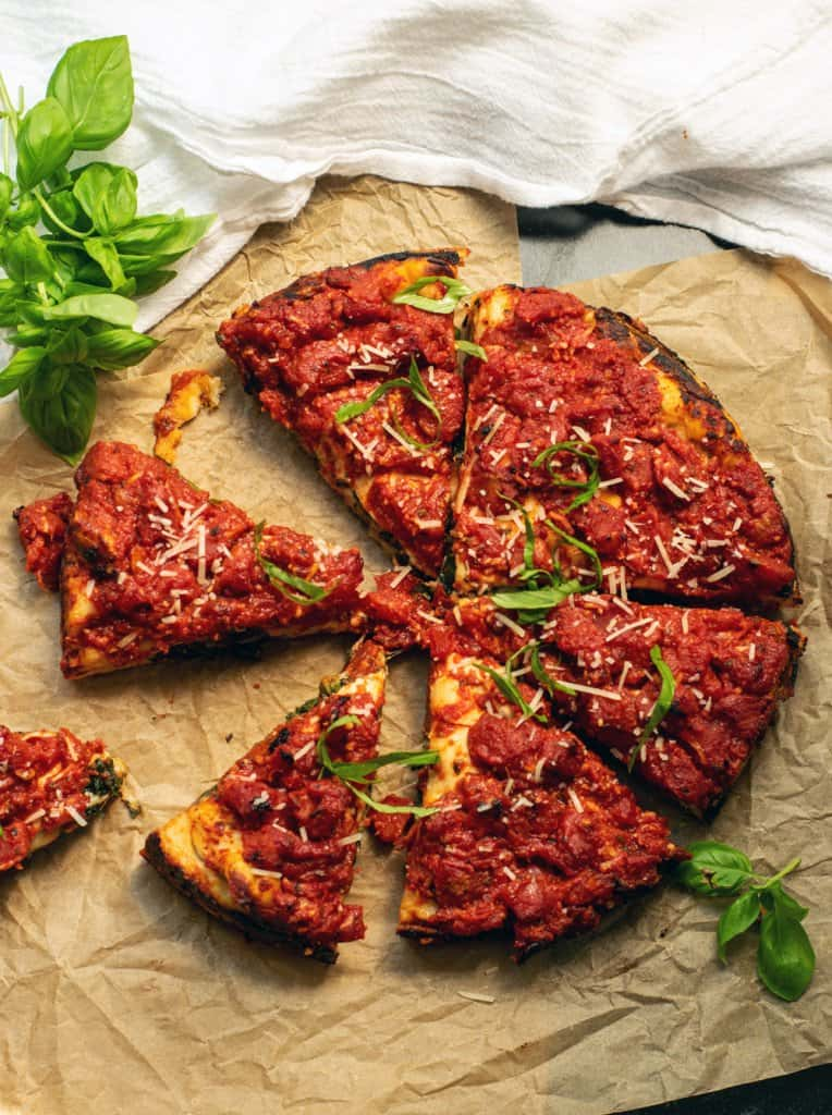 sliced vegetarian spinach stuffed pizza